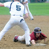 JIM VAIKNORAS/Staff photo Newburyport's Jacob Berger slides safely under the tag of Pentucket's Ryan Kuchar during their game at Pentucket High in West Newbury.