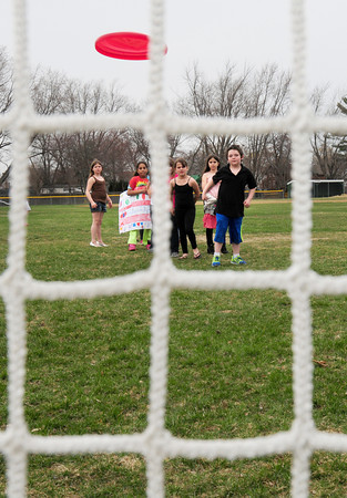 BRYAN EATON/ Staff Photo. After a winter and spring of very little activity at the Boys and Girls Club, children threw frisbees into a soccer net. The club's annual auction and largest fundraiser is this Saturday.