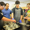 BRYAN EATON/ Staff Photo. Amesbury High School chemistry teacher Mark Casto instructs students as the prepare for experiments using acids. Casto was named Rotary Educator of the Year.