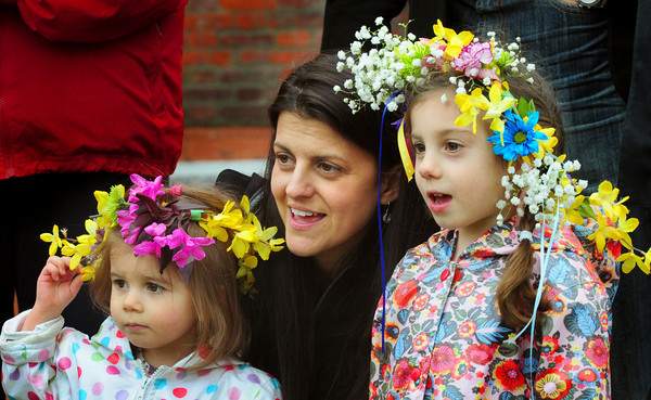 """BRYAN EATON/ Staff Photo. Marriah Kalil of Newburyport sings """"This Land is Your Land"""" with her daughters Sawyer, 20 months, left, and Sadie, 4, who attends the Newburyport Montessori School. The Inn Street and Newburyport Montessori Schools held their Annual May Day celebration parading down Inn Street, up State Street and to Brown Square for some singing."""