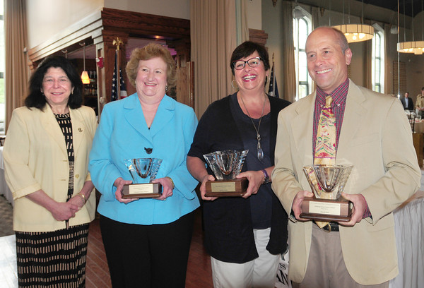 BRYAN EATON/ Staff Photo. Mayor Donna Holaday, left, presented the Yankeed Clipper Council of Boy Scouts' 2014 Distinguished Service Awards to Elizabeth Abby Stearns, Esther Sayer and David Hall on Thursday morning at the Mission Oak Grill.