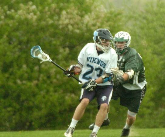 BRYAN EATON/ Staff Photo. Triton's Lawrence Cuddy moves past a Pentucket defender.