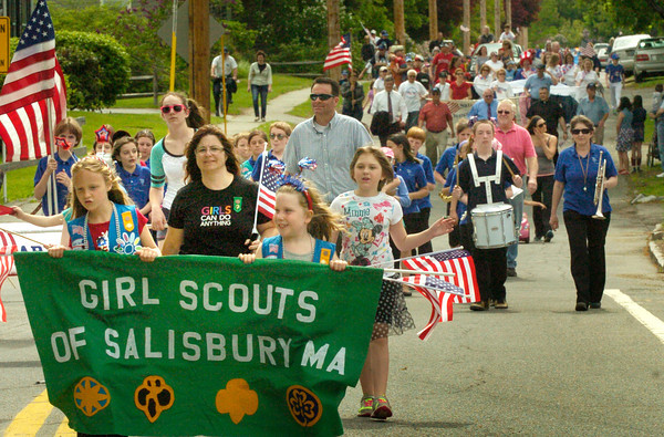 BRYAN EATON/ Staff Photo. The Girls Scouts parade down Pleasant Street in Salisbury followed by the Salisbury Elementary School Band.