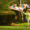 BRYAN EATON/ Staff Photo. Sam Luekens, 4, of Newburyport tries to get his kite off the ground at Newburyport's Waterfront Park. He was there Monday afternoon with his brother Evan, 6, and mother, Elizabeth.