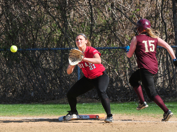 BRYAN EATON/ Staff Photo. Newburyport's  Carley Siemasko is safe on a single as Amesbury first baseman Zoe Fitzgerald waits for the throw.