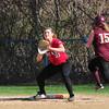 BRYAN EATON/ Staff Photo. Newburyport's  Carley Siemasko is safe on a single as Amesbury first baseman Zoe Fitzgerald waits for the throw.