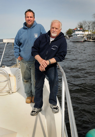 BRYAN EATON/ Staff Photo. Charter boat captains Chris Charos, left, of Captain's Fishing Parties, with one boat, rear, and Bob Yeomans of Erica Lee II are concerned that new regulations could drastically affect their business. The season, which ran from April 15 to mid-to-late October will close this year at the end of August and not open again until May 1st of next year. And customers who used to catch unlimited haddock, now can only catch nine cod and only three haddock.