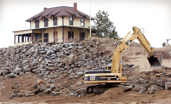 Newbury: Boulders have been put in place at Bennett Hill on Plum Island and more are being installed to the left of the landmark cottage. Bryan Eaton/Staff Photo