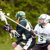 BRYAN EATON/ Staff Photo. Pentucket's Josh Wesolowski  goes for the ball with a North Reading player.
