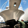 "BRYAN EATON/ Staff Photo. The weather has finally turned spring-like for real this week without the recent rollercoaster temperaturesmaking for nicer outdoor activity. Rich Grillo of Plum Island buffs his 29-foot Phoenix sport fisherman at WIndward Yacht Yard, after waxing it, which he likes to do every year as he says the salt water ""really does a number on it."""