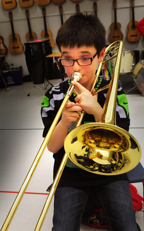 Salisbury: Arthur Stanley, 9, and his fellow Salisbury Elementary School band members practice the theme from Star Wars yesterday afternoon. They were preparing for today's Triton District Arts Festival. Bryan Eaton/Staff Photo