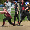 BRYAN EATON/ Staff Photo. Newburyport's Carley Siemasko has throw forcing out the Ipswich player.
