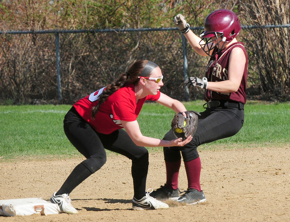 BRYAN EATON/ Staff Photo. Amesbury's Lauren Fedorchak tags out Newburyport's Lauren Singer at second base.