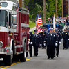 BRYAN EATON/ Staff Photo. The Salisbury fire and police departments lead the Memorial Day Parade down Pleasant Street yesterday.