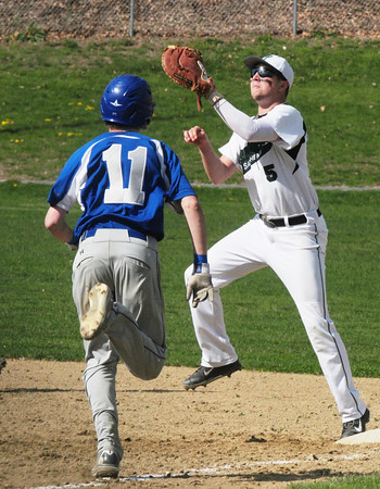 BRYAN EATON/ Staff Photo. Pentucket first baseman Ryan Koucher has the throw forcing out the Georgetown player.