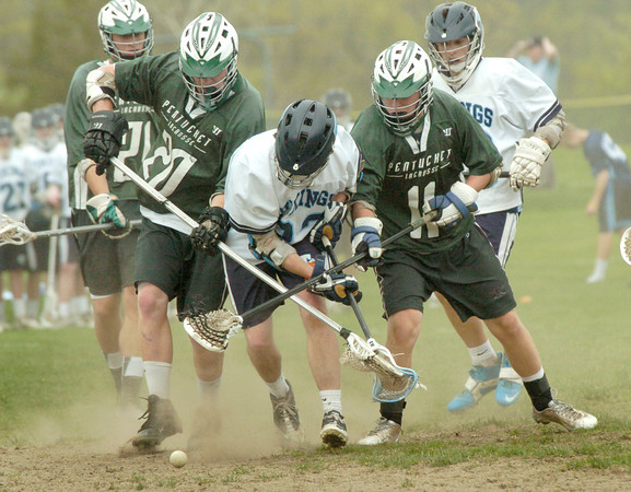BRYAN EATON/ Staff Photo. Triton and Pentucket players scramble for a loose ball in Byfield.