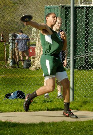 BRYAN EATON/ Staff Photo. Noah Malhi throws the discus for Pentucket.