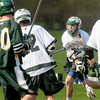 BRYAN EATON/ Staff Photo. One Pentucket player shoots the ball toward the North Reading net.