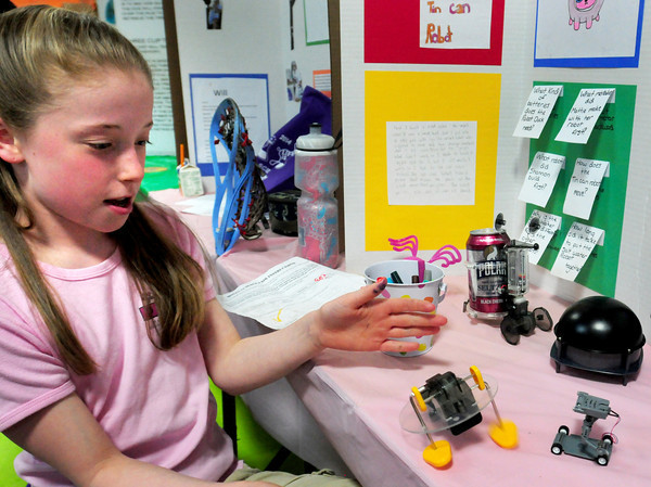 "BRYAN EATON/ Staff Photo. Phoebe Hopkinson, pictured, and teammates Shannon Harrington and Matigan DeFeo, created ""How Different Types of Robots Work."" They were participating in the Molin Upper Elementary School's Science Fair on Thursday morning."