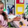 """BRYAN EATON/ Staff Photo. Phoebe Hopkinson, pictured, and teammates Shannon Harrington and Matigan DeFeo, created """"How Different Types of Robots Work."""" They were participating in the Molin Upper Elementary School's Science Fair on Thursday morning."""