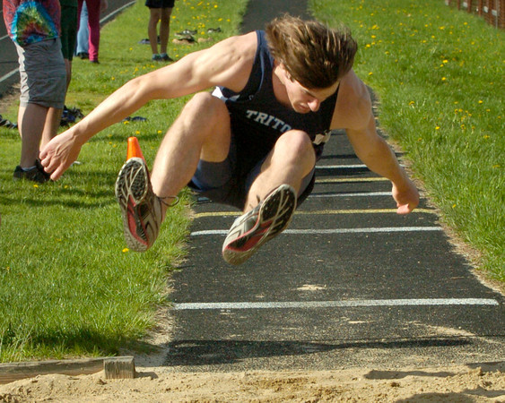 BRYAN EATON/ Staff Photo. Triton's Austin Stevens in the triple jump.