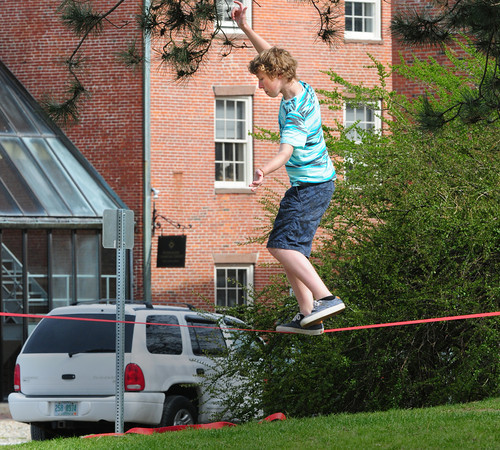 BRYAN EATON/ Staff Photo. Bradley Moore, 13, of Newburyport works on his balance on a slackline at Newburyport's Waterfront Park. He was there with several friends who are trying to improve their balance skills.