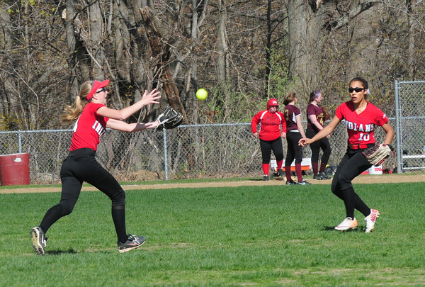 BRYAN EATON/ Staff Photo. A Newburyport fly ball falls between Amesbury's Meagan Aponas, left, and Alixis Boswell.