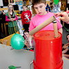 "BRYAN EATON/ Staff Photo. Aiden Notargiacomo and his team demonstrate at ""balloon popper"" a device to make it easier to pop a balloon. He was participating in an Invention Convention at Salisbury Elementary School on Tuesday afternoon."