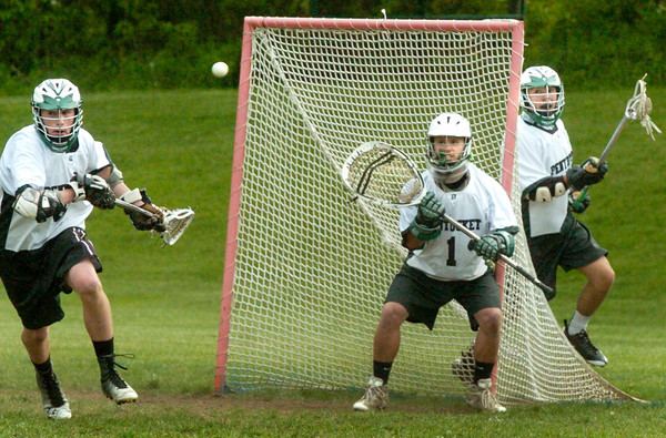 BRYAN EATON/ Staff Photo. Pentucket goalie Brett Connolly waits for a shot by North Reading.