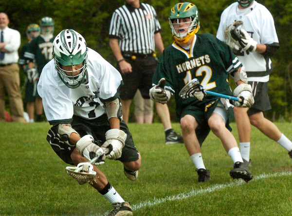 BRYAN EATON/ Staff Photo. Pentucket's Quintin Bounsy snags the ball from North Reading's Onanian.