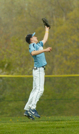 BRYAN EATON/ Staff Photo. Triton's Jack Germinara catches a Pentucket pop fly.