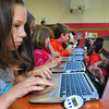 BRYAN EATON/ Staff Photo. Third grade students in physical education classes learn to imput data from pedometers, one in foreground, at the Brown School as they track their steps during the day and activity in the classes. The lap tops were donated by the NEF and pedometers by Newburyport Elementary PTO, Mass. Walk to School and the Anna Jaques Hospital.