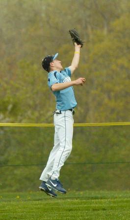 BRYAN EATON/ Staff Photo. Triton's Jack Germinara catches a Pentucket pop fly.