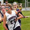 BRYAN EATON/ Staff Photo. Triton's Sarah Ganzenmuller puts the pressure on Newburyport's Olivia Kearney.