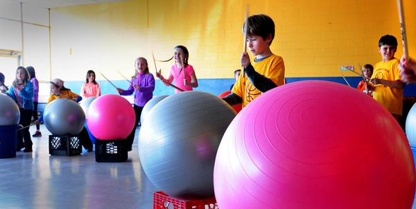 """Newburyport: Students at the Bresnahan School participate in """"Drums Alive"""" in Cathy Hill's physical education class on Tuesday. The children beat the excercise balls and make different moves around them while keeping a beat in this fun physical activity. Bryan Eaton/Staff Photo"""