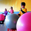 "Newburyport: Students at the Bresnahan School participate in ""Drums Alive"" in Cathy Hill's physical education class on Tuesday. The children beat the excercise balls and make different moves around them while keeping a beat in this fun physical activity. Bryan Eaton/Staff Photo"