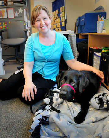 BRYAN EATON/ Staff Photo. Jennifer O'Rourke with Warren is the new therapy dog for special education students at Salisbury Elementary School.