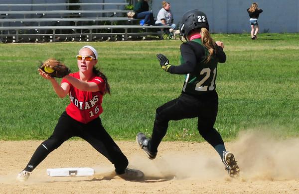 BRYAN EATON/Staff Photo. Manchester-Essex player #21 steals second under Amesbury second baseman Lauren Fedorchak.