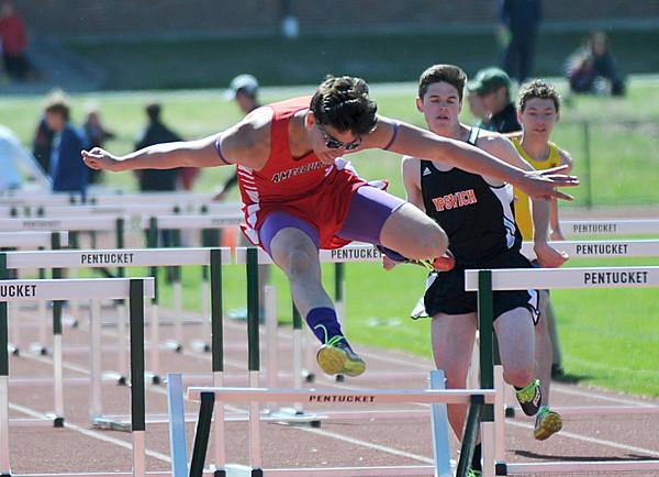 JIM VAIKNORAS/Staff photo <br /> Amesbury's Adam Elfiki in teh 100 meter High Hurdles at the CAL track championships
