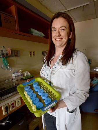 BRYAN EATON/Staff Photo. Alison Sekelsky keeps donated breast milk frozen.