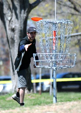 JIM VAIKNORAS/Staff photo Pete Charron makes a shot while playing dics golf at Amesbury Park Saturday .