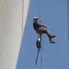 JIM VAIKNORAS/Staff photo  Mark Richie clean the turbine at his property on Parker Street in Newburyport.