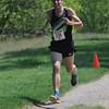 JIM VAIKNORAS/Staff photo <br /> Winner Nate Jenkins sprints to the finish at Trav's Trail Run at Maudslay State Park in Newburyport.