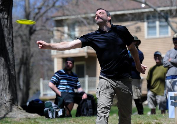 JIM VAIKNORAS/Staff photo Todd Goodman with a tee shot while playing dics golf at Amesbury Park Saturday .