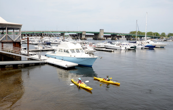 JIM VAIKNORAS/Staff photo <br /> Two kayakers head out in the Merrimack River near the board walk in Newburyport on a warm morning this past weekend.