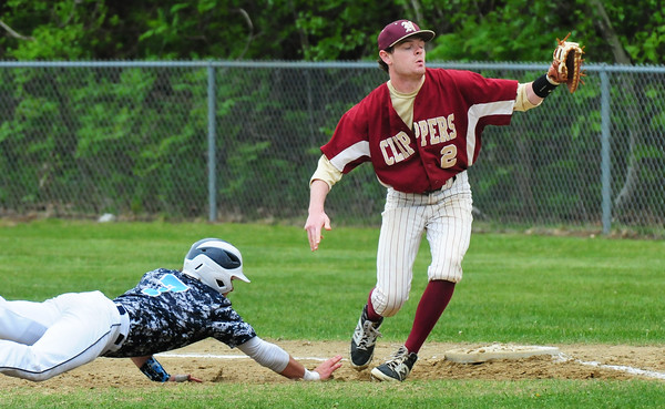 BRYAN EATON/Staff Photo. The pick flies past Newburyport first baseman Jake Barlow allowing Triton's James Wood III to go on to steal second.