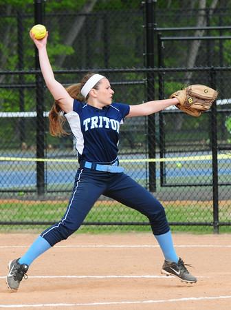 BRYAN EATON/Staff Photo. Triton catcher Maggie Riccio is action with Pentucket.
