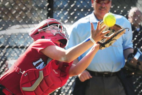 BRYAN EATON/Staff Photo. Amesbury catcher Caitlyn Baker catches a foul ball.