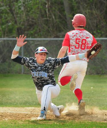 BRYAN EATON/Staff Photo. Masco's Rich squeaks by Triton first baseman Adam Chatterton for the base.