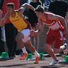 JIM VAIKNORAS/Staff photo <br /> Newburyport's Donte Harmon and Amesbury's Doug Masi in the 100 meter dash at the CAL track championships